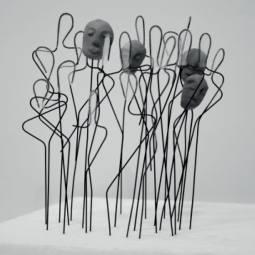 this sculpture is made out of wires and clay. all forms are handmade. the traffic of the body silhouettes and just some of them with a face, symbolize the search of induviduality.