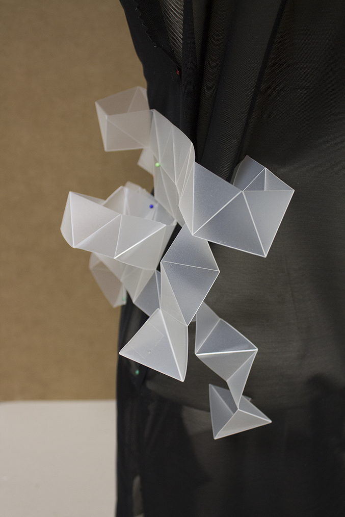 a geometrical experiment with folded plastic. the carved in triangles allow a high flexibility of the material and the transformation into polygones.